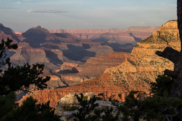The grand canyon stretches out to the Arizona horizon in layers of deep canyons.