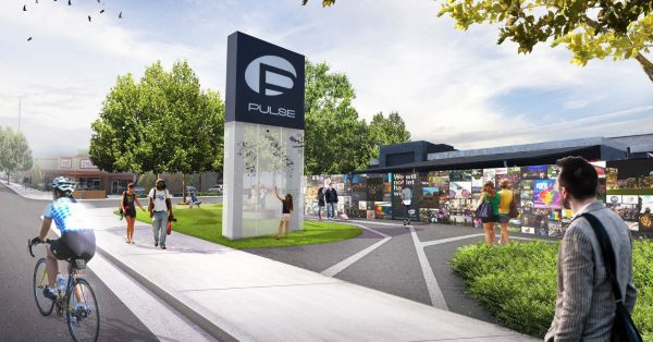 Designer's image of potential PULSE memorial building with visitors commemorating LGBTQ+ history.