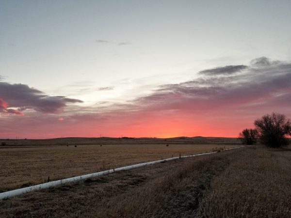 The sun rises over Colorado State Trust Land.