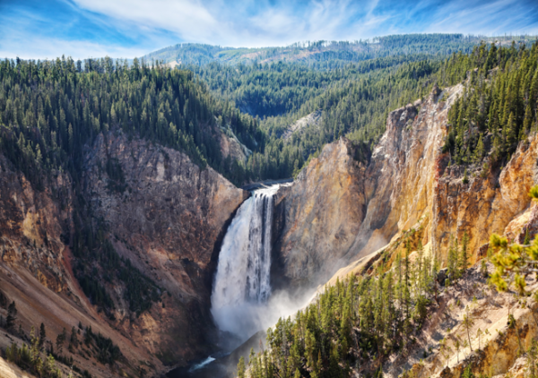 At Yellowstone National Park, a waterfall cascades into a deep canyon.