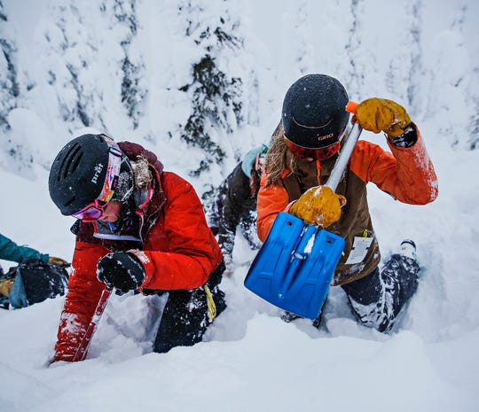 Image of students participating in an avalanche safety course.